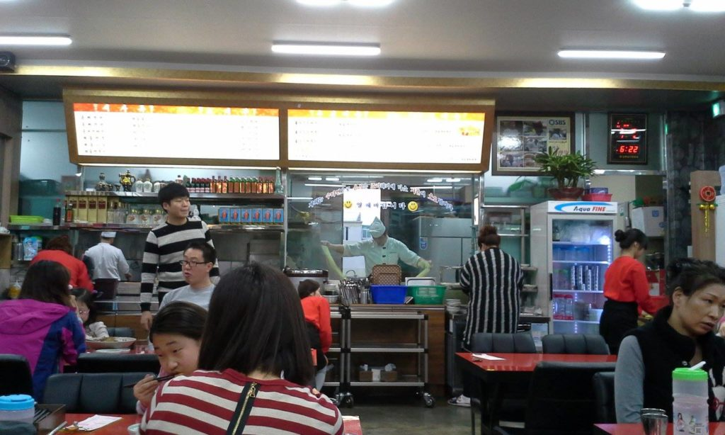 You can watch the chefs prepare noodles in the kitchen.
